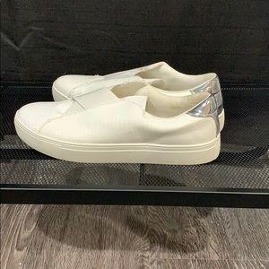 White slip on sneakers.